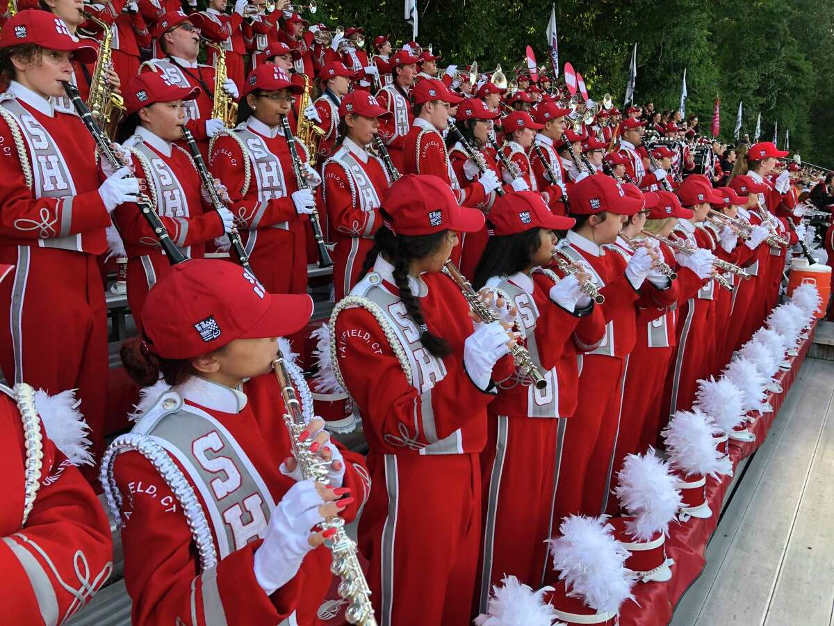 Sacred Heart University Marching Band performs during a previous football season, pre-COVID.