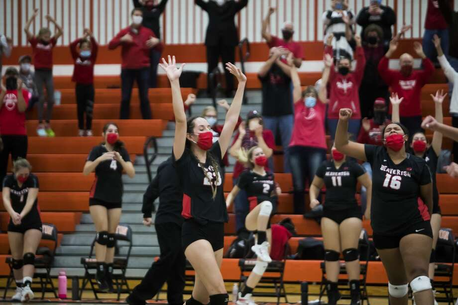 Beaverton's Hannah Stearns (23) and Leiyah Mungin (16) celebrate, along with their teammates, following their regional final victory over McBain on Nov. 12, 2020. Photo: Daily News File Photo