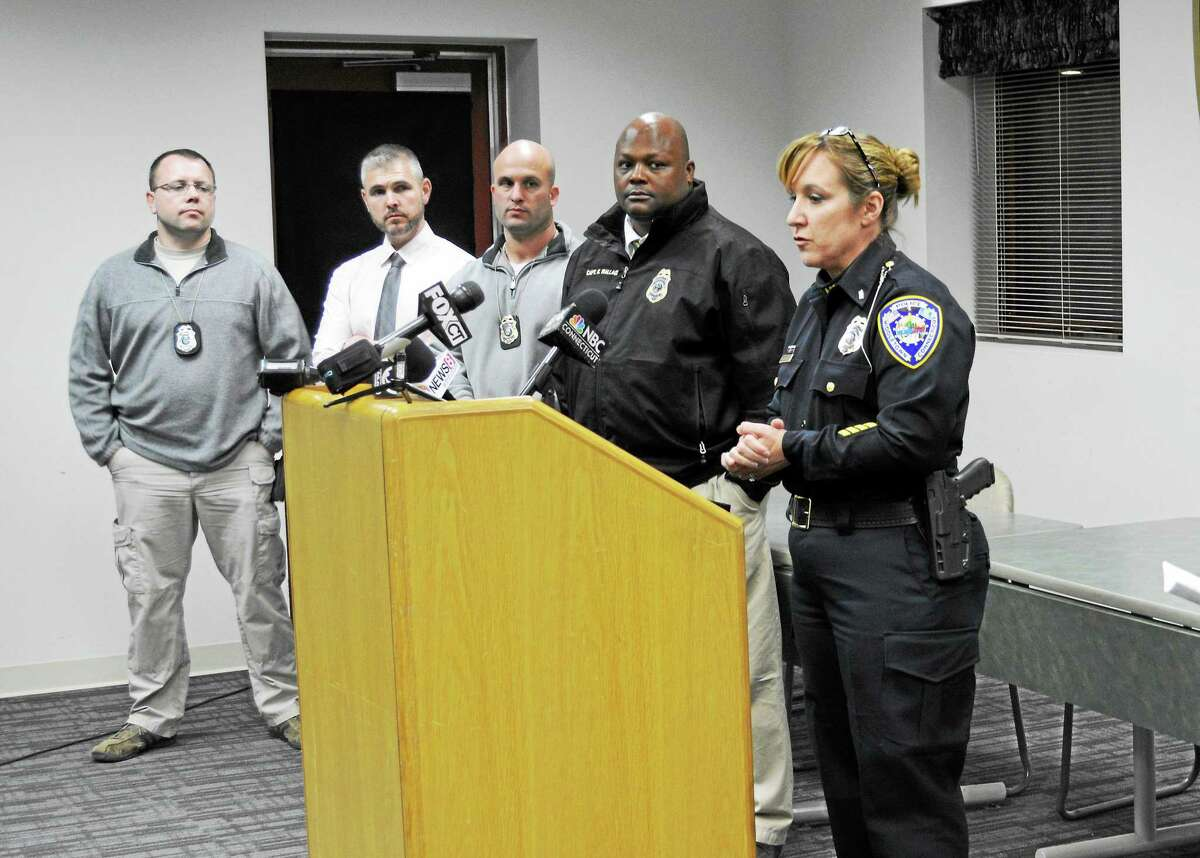 Retired Middletown police Lt. Heather Desmond, far right, talks to reporters about an incident at Wesleyan University in September 2017.