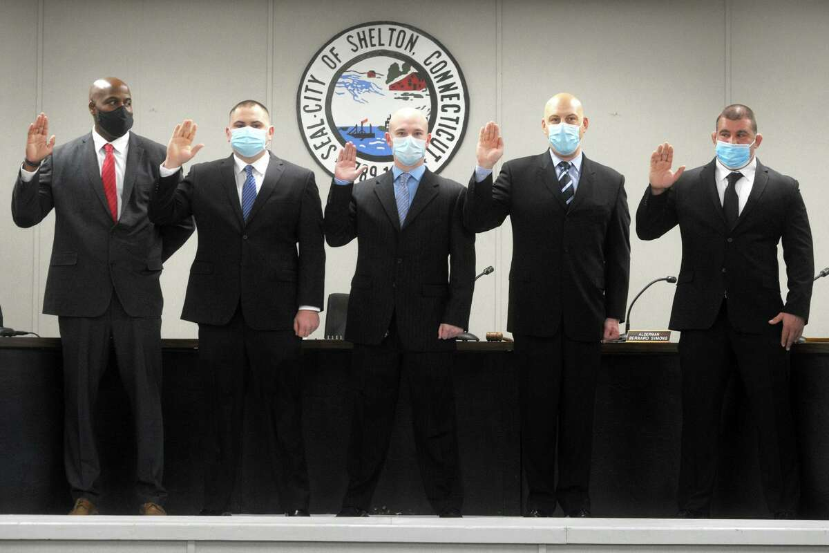 Five new Shelton police officers are sworn in, from left, Timothy Greene, John McMahon, Michael Dinihanian, Dominick Muoio and John Cannata at City Hall in Shelton, Conn. Jan. 11, 2021.