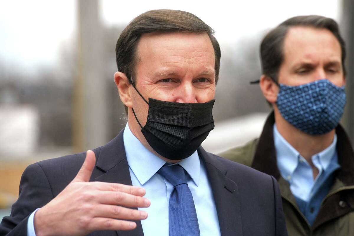 U.S. Sen. Chris Murphy speaks during a tour of the Thomas Merton Center, in Bridgeport on Monday. Murphy is seen here with U.S. Rep. Jim Himes.