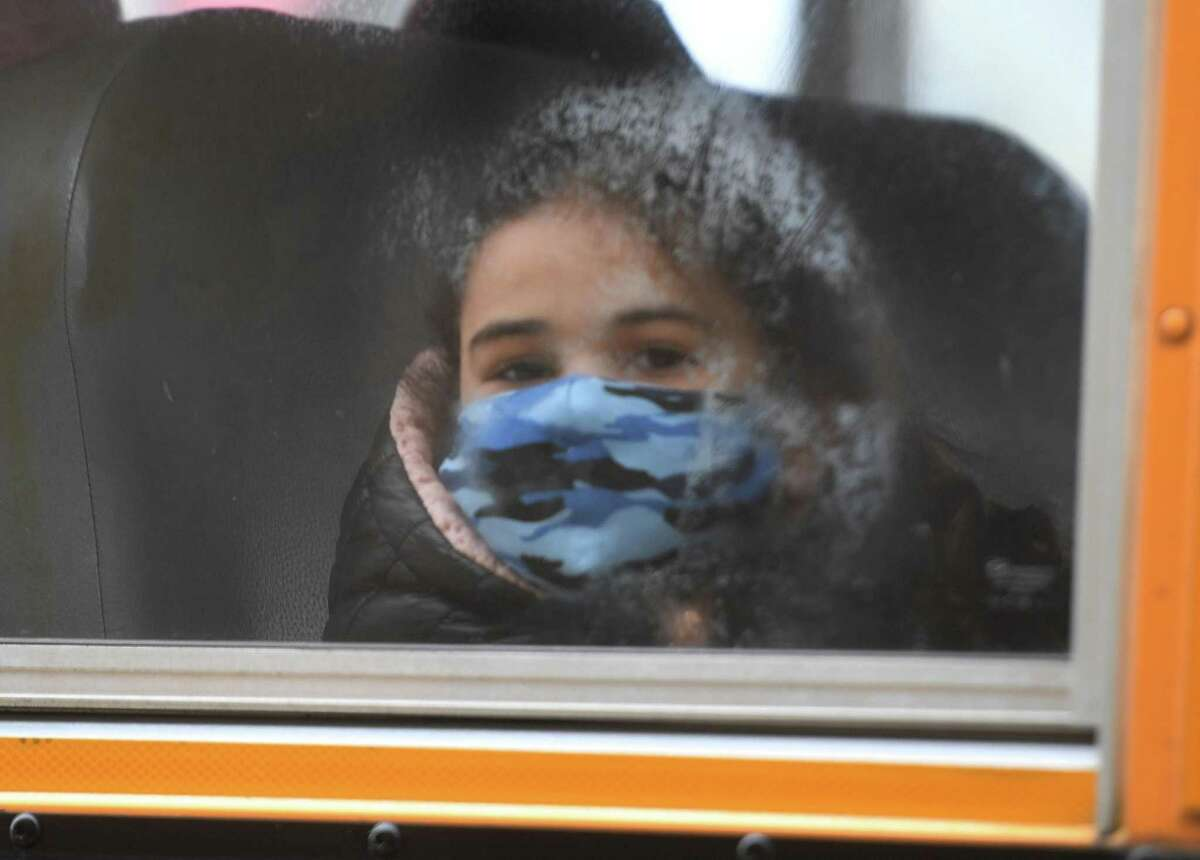 Buses return students to school after two months of remote home instruction at Long Hill Elementary School in Shelton, Conn. on Monday, January 11, 2021.