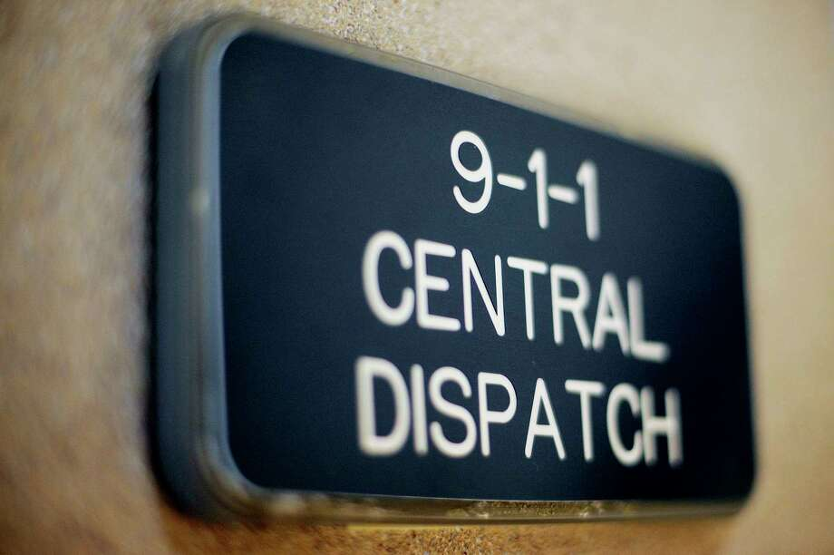 FILE -- A sign at the entrance to the Midland Central Dispatch Authority office in the Law Enforcement Center. (Nick King/Midland Daily News file) / Midland Daily News
