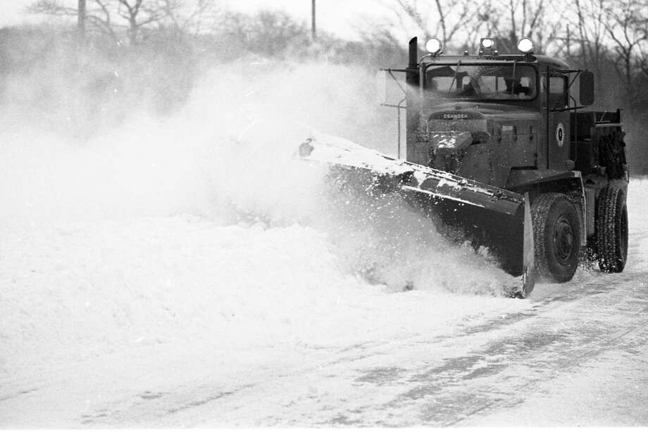 """From the Jan. 12, 1981 front page of the News Advocate, """"This county truck, a 10-ton Oshkosh with a side plow, sent snow flying on Merkey Road in the morning hours."""" (Manistee County Historical Museum photo)"""