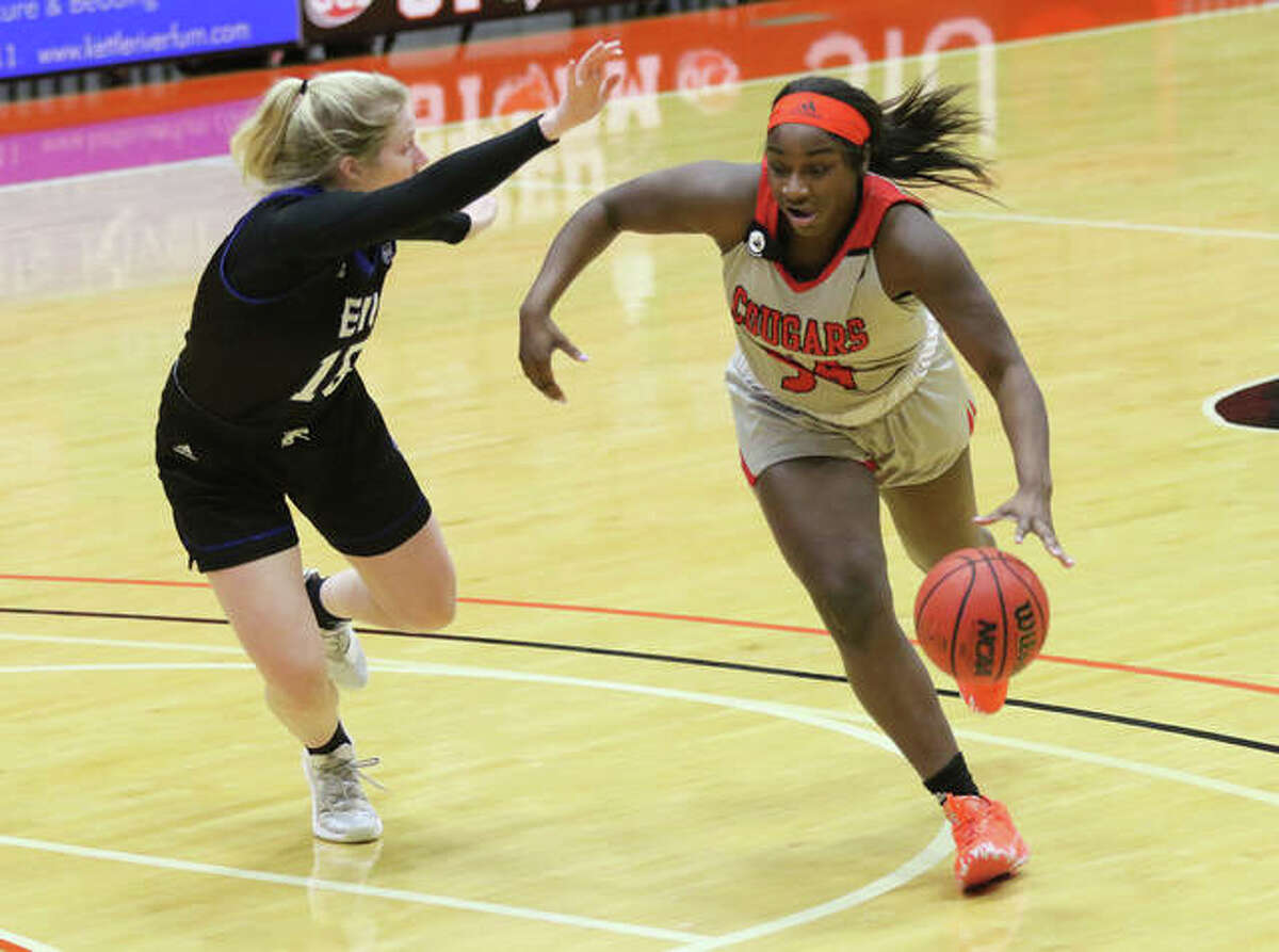 SIUE's Kelsie Williams (right) drives on Eastern Illinois' Taylor Steele during the first half Monday afternoon at First Community Arena in Edwardsville.