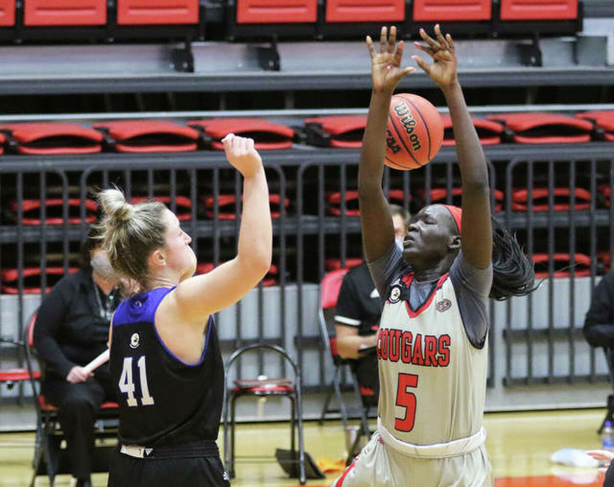 SIUE's Ajulu Thatha (5) has her shot knocked away by Eastern's Abby Wahl in the second half Monday at First Community Arena in Edwardsville.