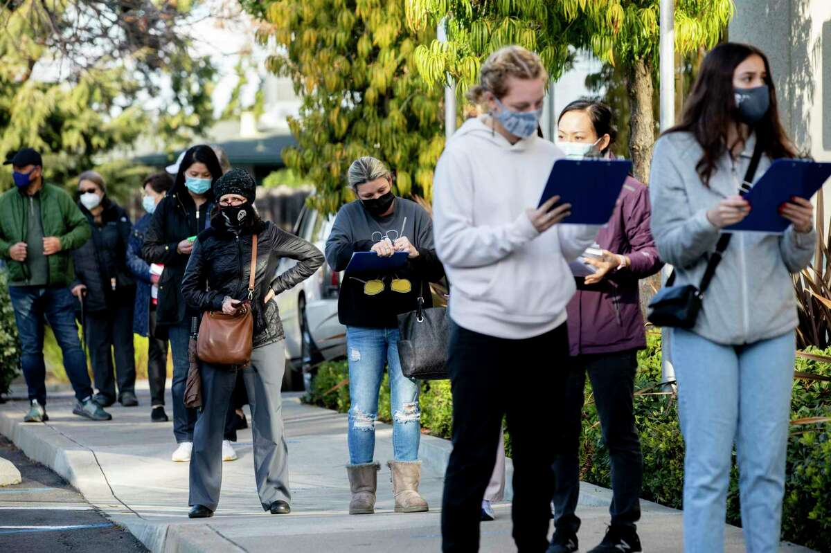 Hundreds of Alameda County workers lined up outside of St. Rose Hospital in Hayward, Calif. Friday, January 8, 2021to receive their first and second doses of the Pfizer and Moderna vaccines after being invited to make an appointment through their workplaces.