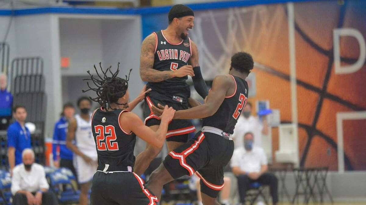 Jordyn Adams (5) celebrates with his teammates during a win over Eastern Illinois. It was Adams first game in more than a month.