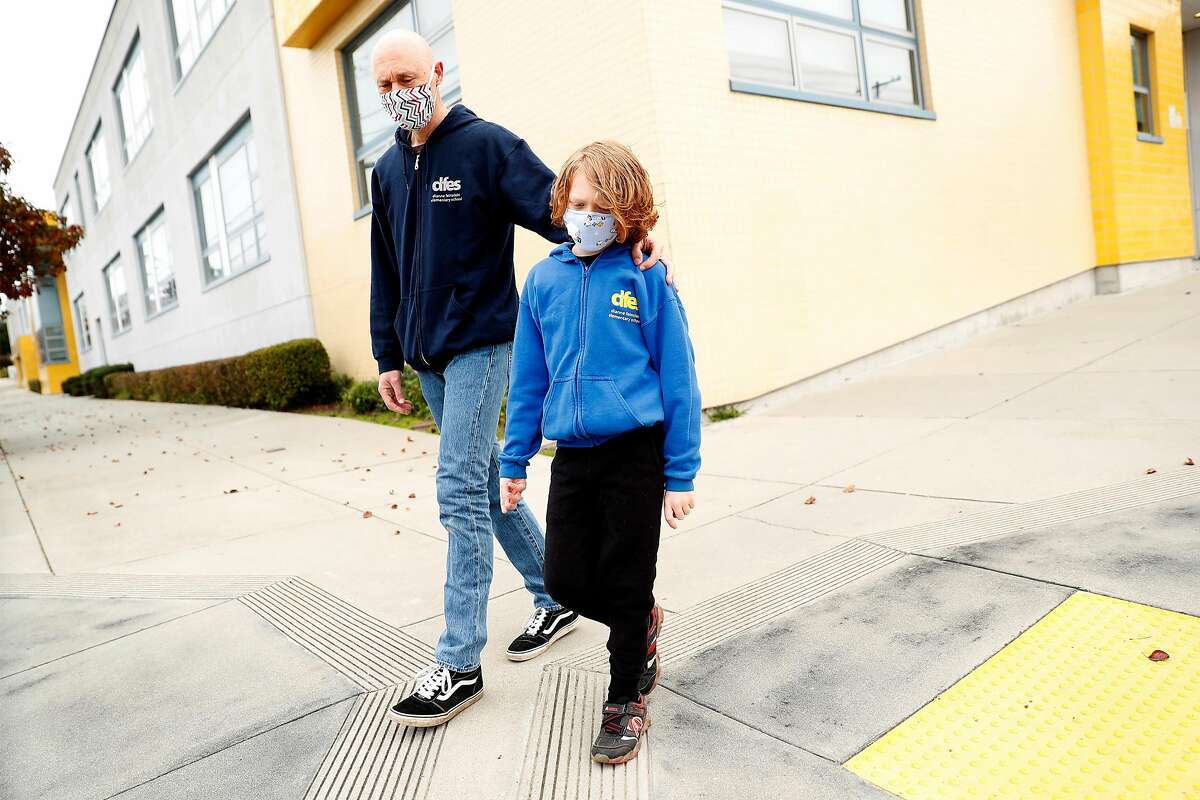 Bryan McDonald and his second grade son, Travis, outside Dianne Feinstein Elementary School in San Francisco, Calif., on Sunday, January 10, 2021. McDonald objects to the school board's demand that the school change its name.