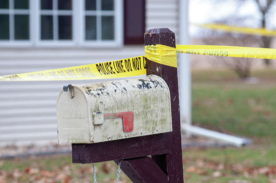 Police tape marks off a property in Virginia after a shooting there Sunday. Photo: Darren Iozia | Journal-Courier / Jacksonville Journal-Courier