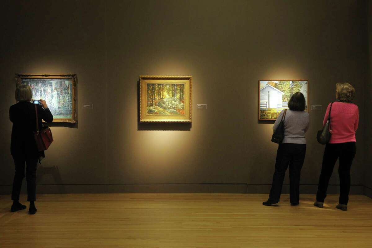 Visitors look at paintings on display at the New Britain Museum of American Art, in New Britain, Conn. Jan. 16, 2019. The museum celebrates Martin Luther King Day this year with a series of events and free admission, Jan. 18-22.