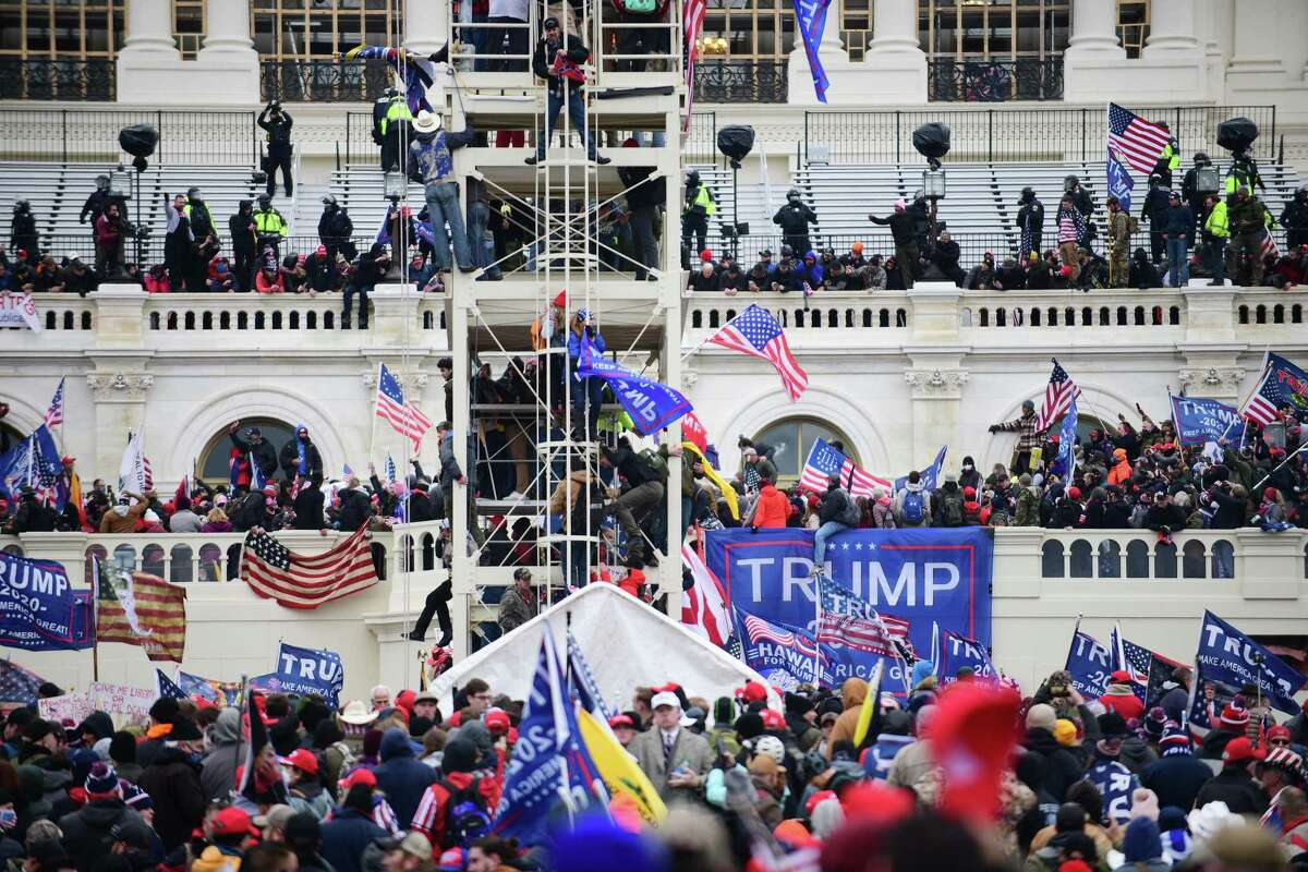 Supporters of President Donald Trump riot at the U.S. Capitol on Jan. 6, 2021.