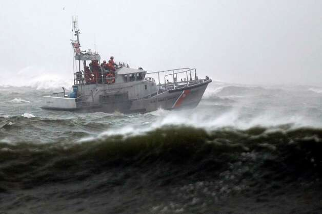 A Coast Guard vessel is seen off the coast of Atlantic City, N.J., as Hurricane Earl moves up the eastern coast, Friday, Sept. 3, 2010.  (AP Photo/Matt Rourke) Photo: Matt Rourke, AP / Associated Press