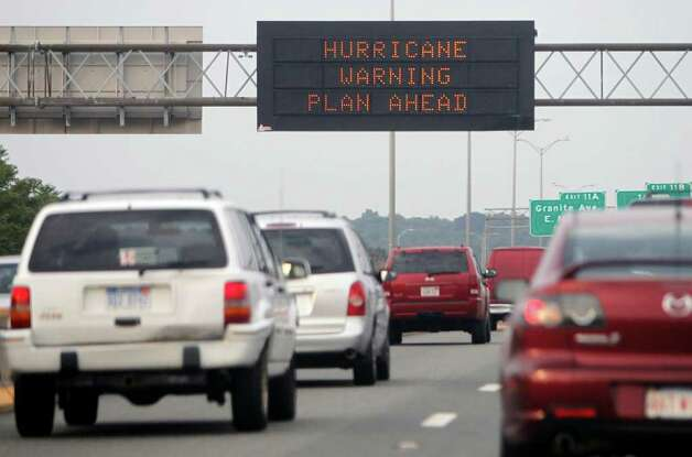 A highway sign warns of approaching Hurricane Earl on I-93 south in Boston, Friday, Sept. 3, 2010. (AP Photo/Michael Dwyer) Photo: Michael Dwyer, ASSOCIATED PRESS / Associated Press