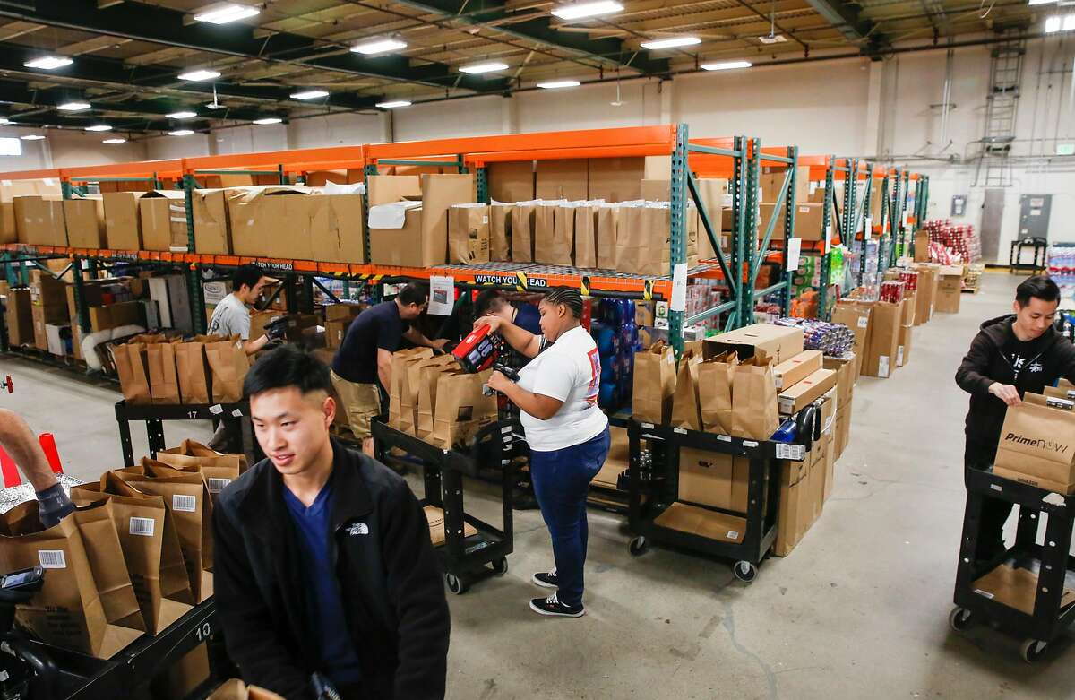 Workers fill orders at the Amazon Prime Now center in San Francisco. Warehouse fulfillment roles are among jobs where there are many openings.