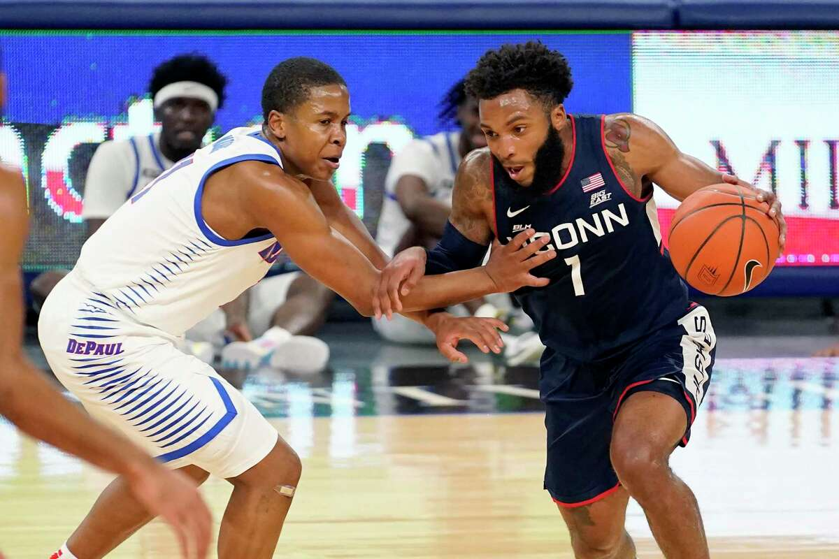 UConn's R.J. Cole (1) drives against DePaul's Charlie Moore during the first half on Monday in Chicago.