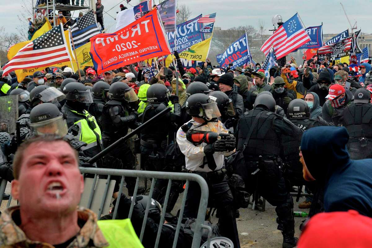 """Trump supporters clash with police and security forces as people try to storm the U.S. Capitol Jan. 6, 2021. Conservative pollster Frank Luntz found that 64 percent of Trump supporters agree with the premise that """"the traditional American way of life is disappearing so fast that we may have to use force to save it."""""""