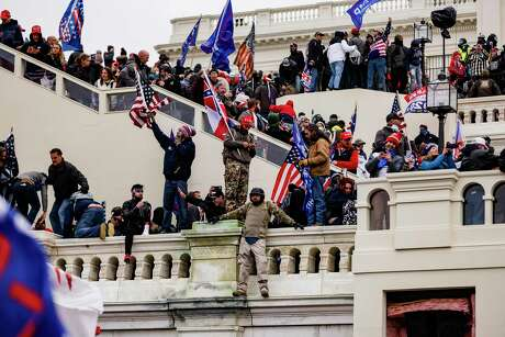 Pro-Trump supporters storm the U.S. Capitol following a rally with President Donald Trump on Jan. 6, 2021.