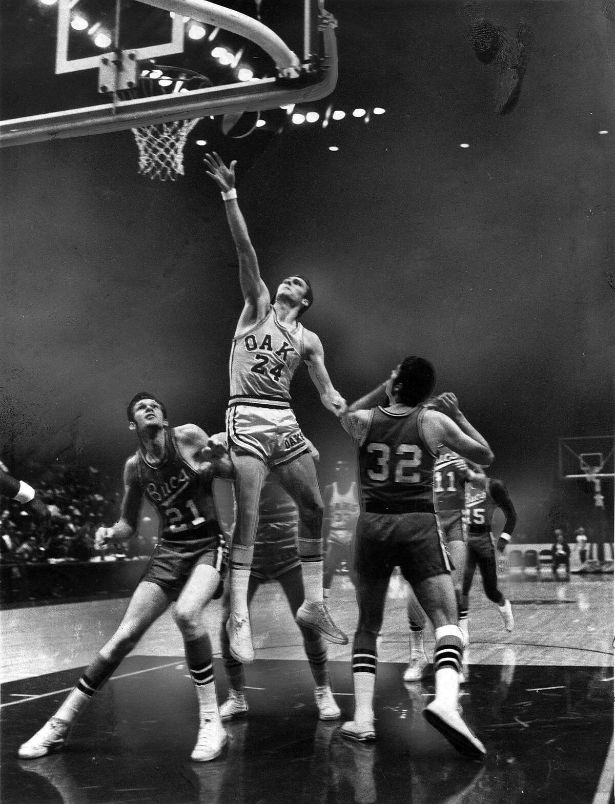 The Oakland Oaks' Rick Barry scores in a game against the New Orleans Buccaneers during a game in October 1968.