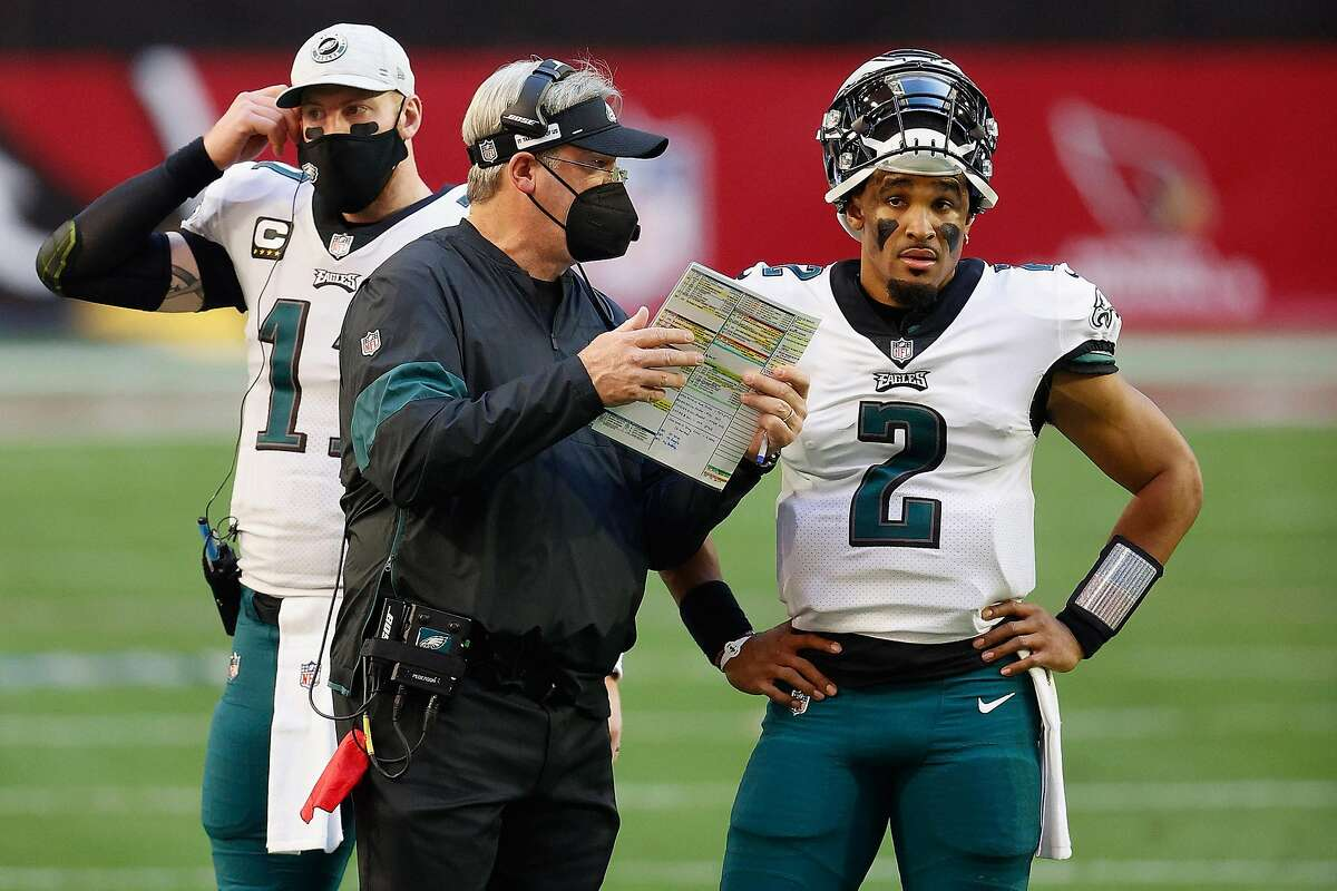Head coach Doug Pederson of the Philadelphia Eagles talks with quarterback Jalen Hurts (2) during a game against the Arizona Cardinals on Dec. 20, 2020 at State Farm Stadium in Glendale, Arizona. (Christian Petersen/Getty Images/TNS)