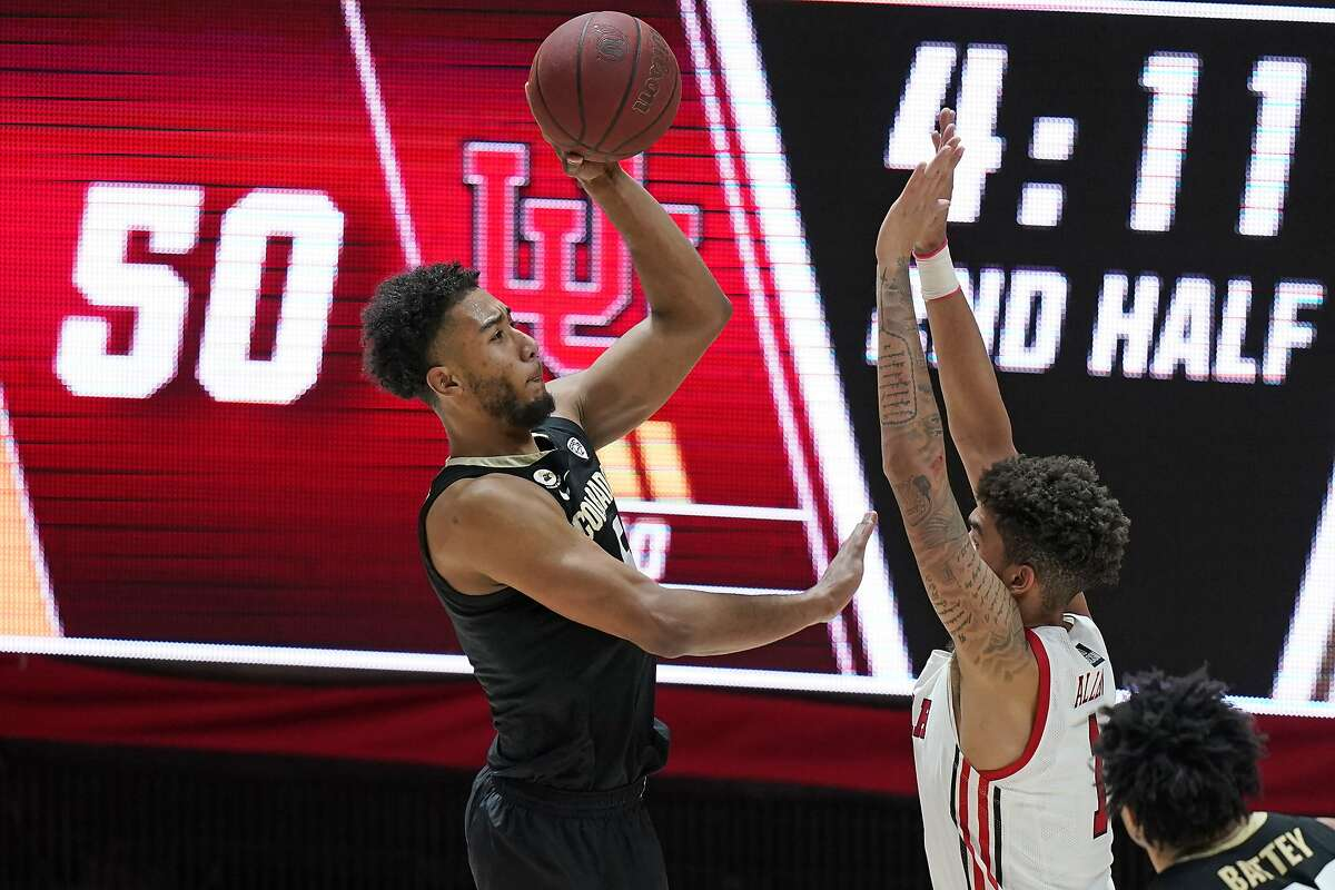 Colorado guard D'Shawn Schwartz, left, shoots as Utah forward Timmy Allen, right, defends in the second half during an NCAA college basketball game Monday, Jan. 11, 2021, in Salt Lake City. (AP Photo/Rick Bowmer)