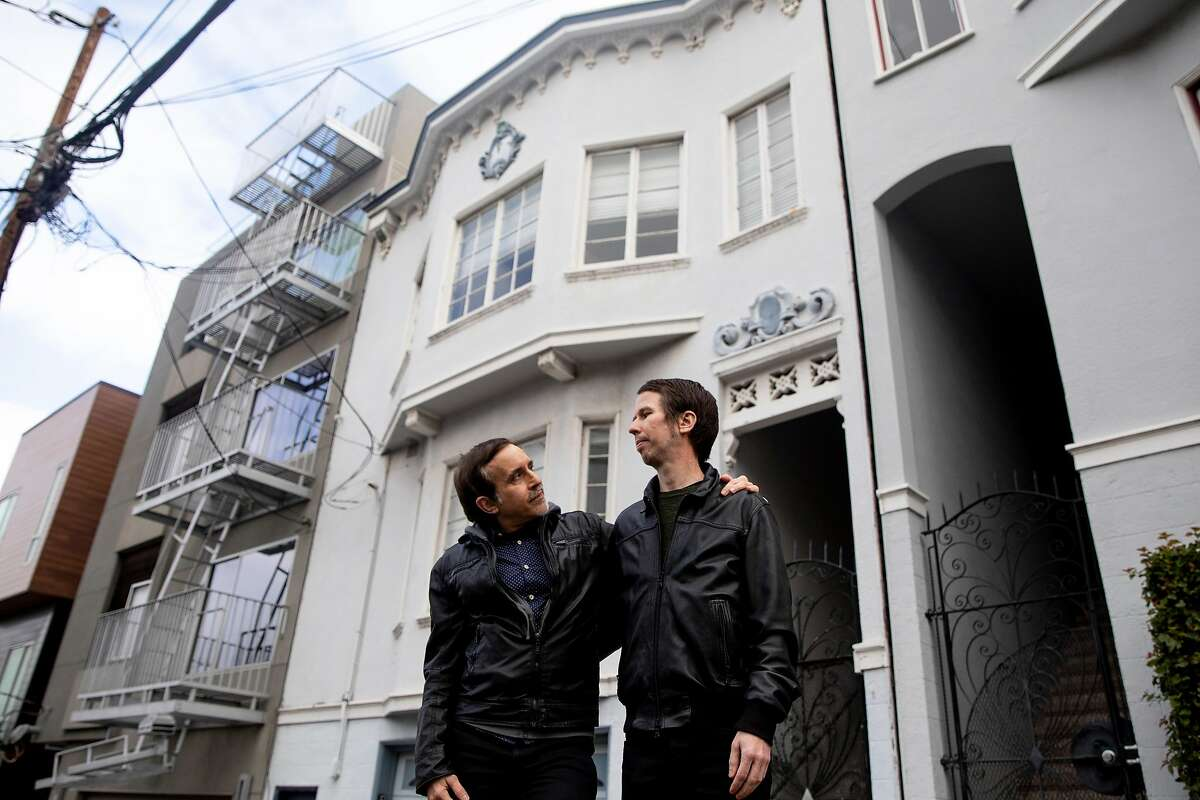 Sean McCormick (left) and Alex Westhoff pose for a portrait outside of the home they were scammed out of in San Francisco, Calif. Friday, January 8, 2021. McCormick and Westhoff were the victims of a real estate scam where they paid $13,000 to rent an apartment at 2630 Leavenworth from someone who didn't actually own it. They thought they had signed a lease to move to North Beach but lost their money instead.