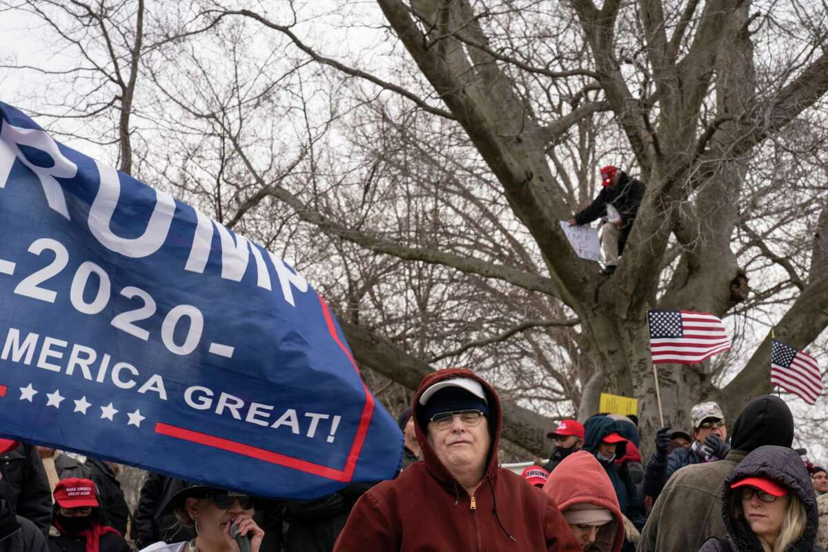 Trump supporters stand rally near the Capitol on Wednesday, Jan. 6, 2021.