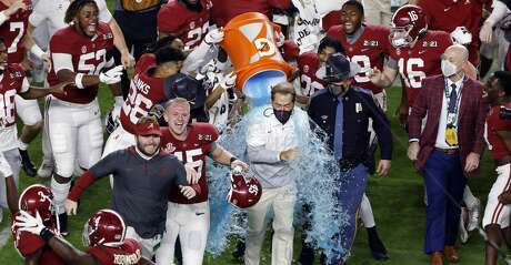 Head coach Nick Saban of the Alabama Crimson Tide is dunked with gatorade following the College Football Playoff National Championship game in-which they defeated the Ohio State Buckeyes 52-24 at Hard Rock Stadium on January 11, 2021 in Miami Gardens, Florida. (Photo by Michael Reaves/Getty Images)