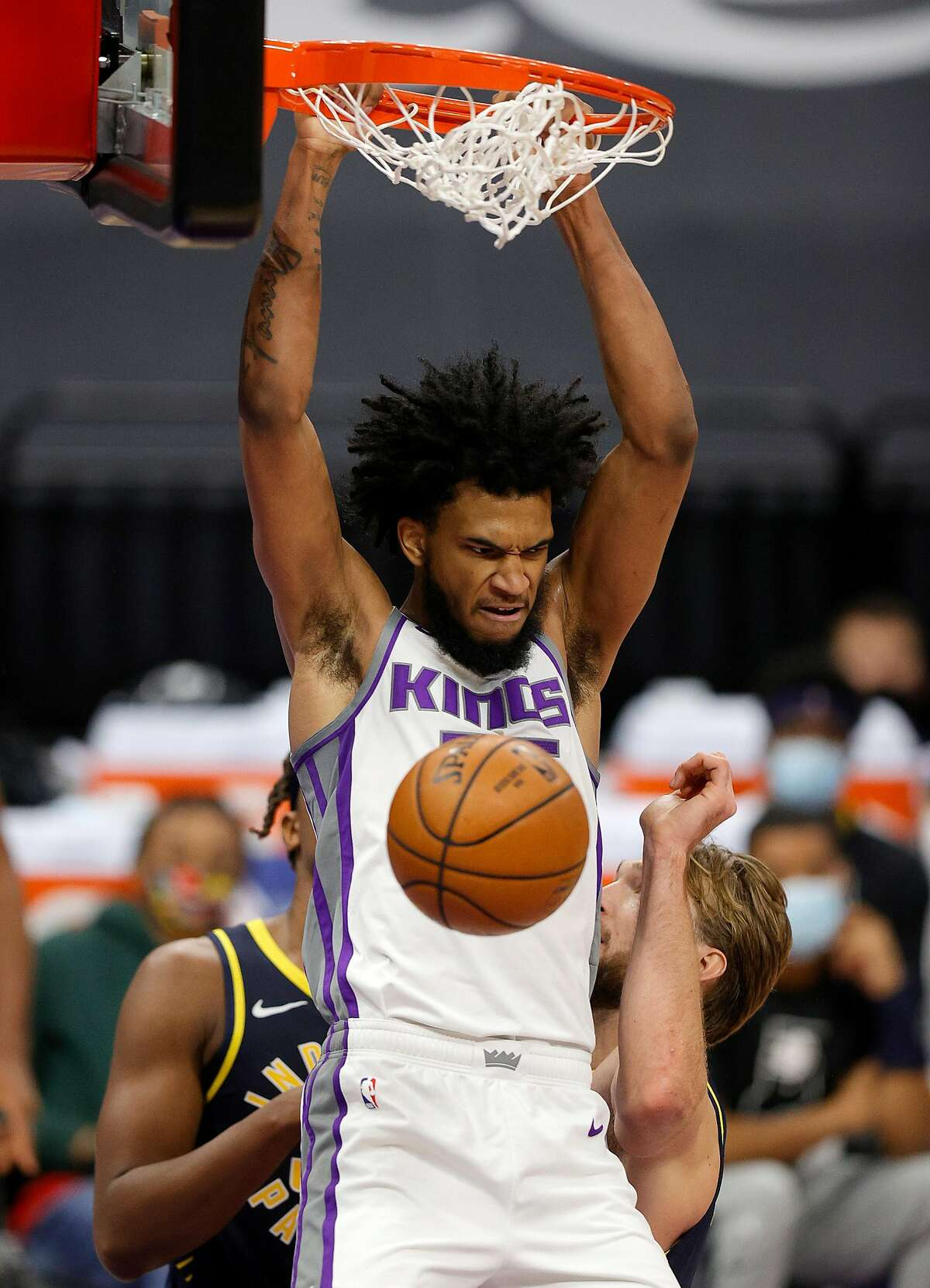 The Kings' Marvin Bagley III dunks on Domantas Sabonis #11 of the Indiana Pacers at Golden 1 Center in Sacramento.
