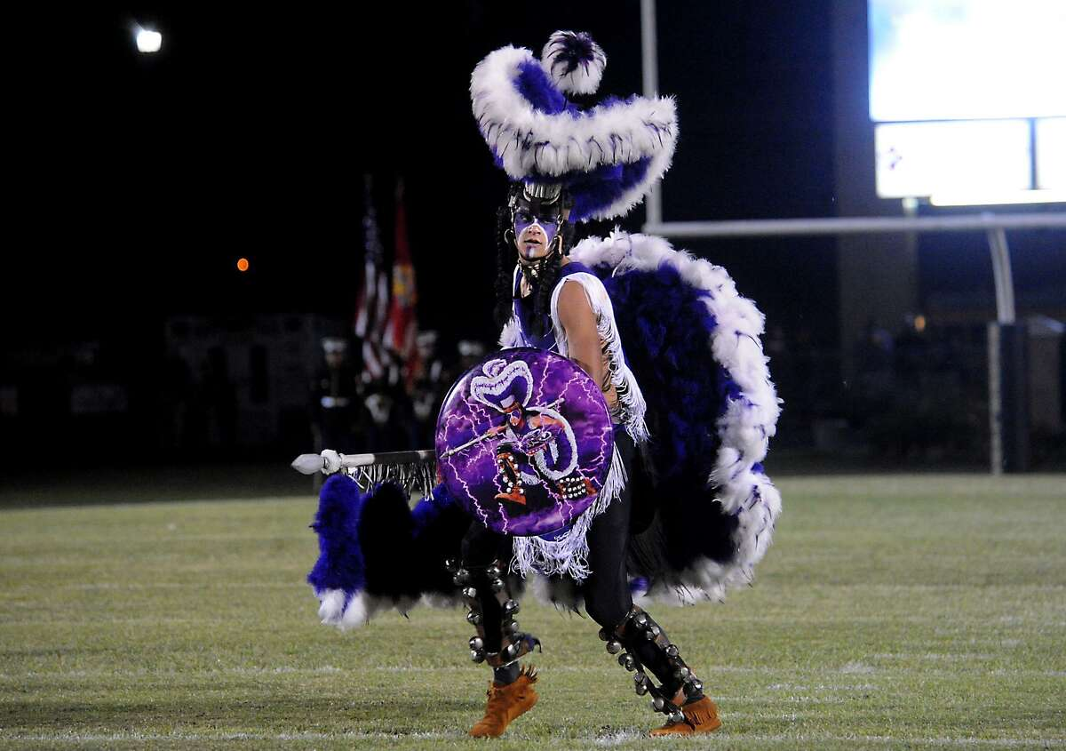 The PN-G mascot performs before the team takes on Nederland at the Bulldog Stadium in Nederland, Friday. Tammy McKinley/The Enterprise