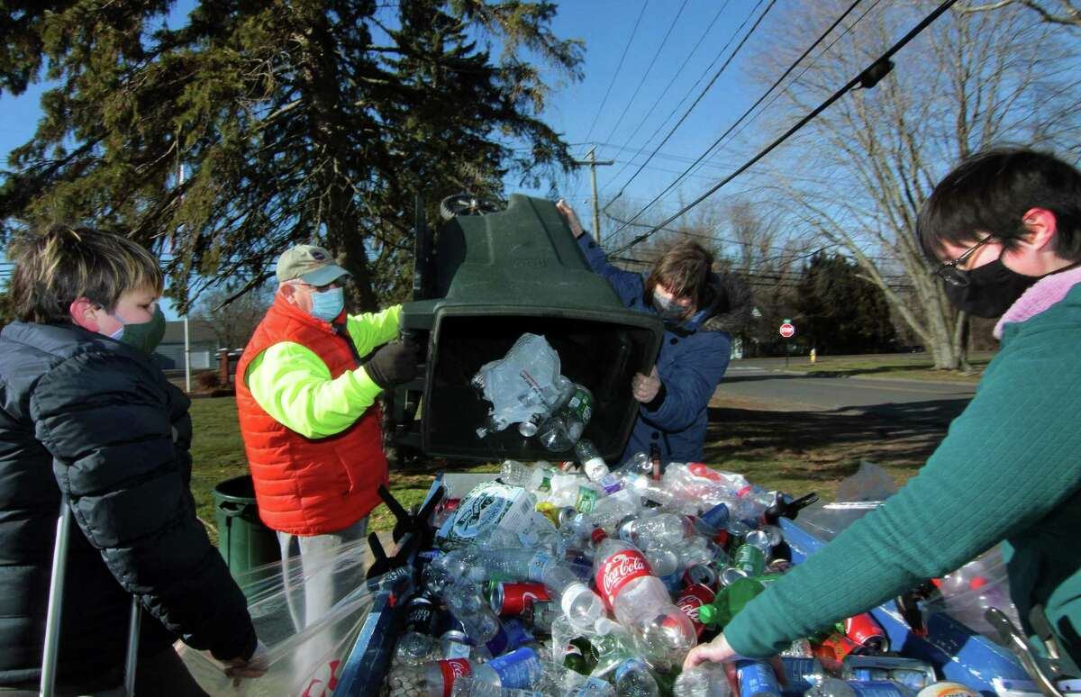 Boy Scout Troop 25 holds its monthly redeemable bottle and can drive at First United Methodist Church on Saturday. From left to right is scout Tim Andrade, 12, Dave Mills, Maggie Andrade and Meg Andrade.