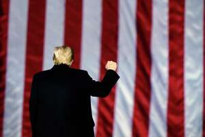 In this Monday, Jan. 4, 2021, file photo, President Donald Trump gestures at a campaign rally in support of Senate candidates Sen. Kelly Loeffler, R-Ga., and David Perdue in Dalton, Ga. Trump will travel to Texas on Tuesday, Jan. 12, 2021, to trumpet one of the pillars of his presidency: his campaign against illegal immigration.