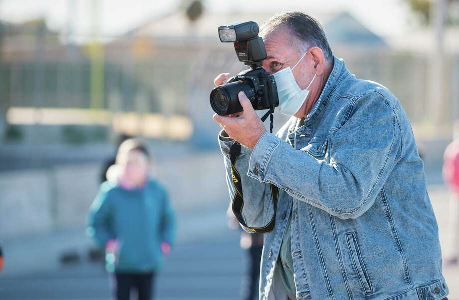 Former Laredo Morning Times chief photographer Cuate Santos photographs Webb County Constable Rudy Rodriguez's Angel of Hope event on Monday, Dec. 14 behind Dovalina Elementary School. Photo: Danny Zaragoza / Laredo Morning Times