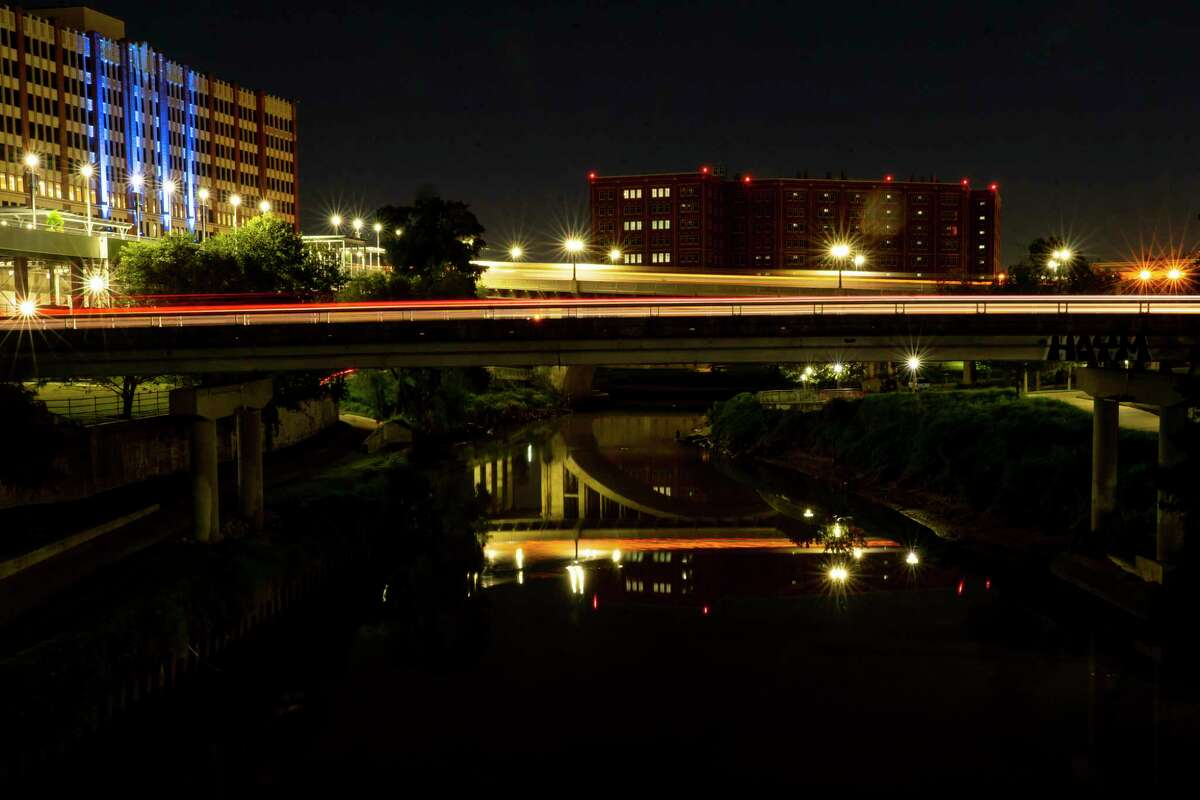 Vehicles cross Buffalo Bayou west of the Harris County Jail (right) on Thursday, Dec. 17, 2020, in downtown Houston. Harris County is looking to switch to using renewable energy to power its buildings, something the city is already doing. On the left is the University of Houston Downtown.