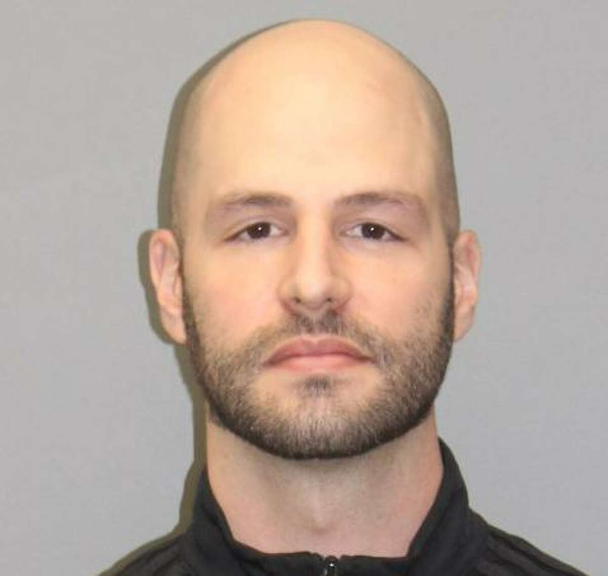 Adam Randazzo, 35, of Barbara Road in South Windsor, Conn., with eight counts of illegal possession of a high-capacity magazine when he turned himself in at police headquarters around 6 p.m. Monday, Jan. 11, 2021.