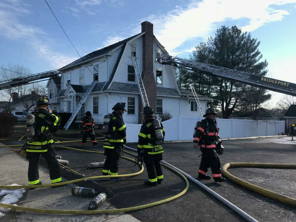 Units on scene for a two-alarm fire on Ochsner Place in Bridgeport, Conn., on Tuesday, Jan. 12, 2021.