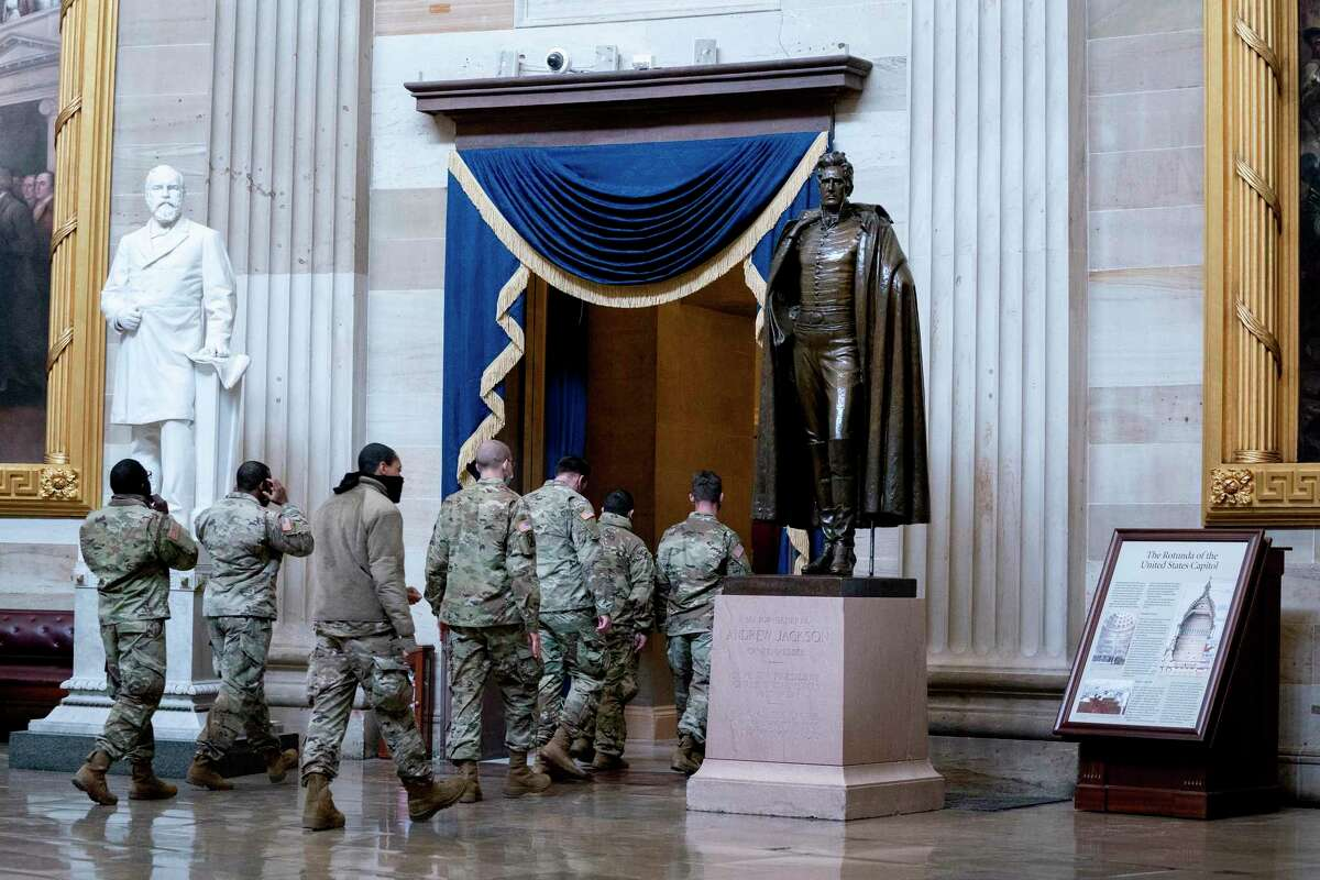 Members of the National Guard walk through the rotunda of the U.S. Capitol on Jan. 11, 2021 in Washington, D.C.