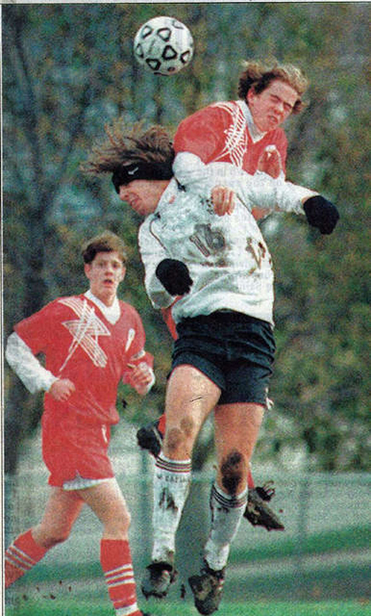 Edwardsville's Justin McFarland, middle, goes up for a header during a state quarterfinal game against Palatine in 1995.