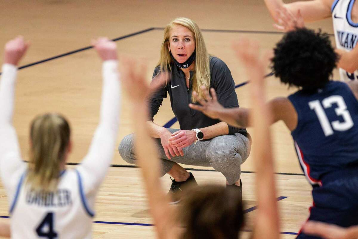 Villanova coach Denise Dillon watches from the sideline during the second half of the team's NCAA college basketball game against Connecticut, Tuesday, Dec. 22, 2020, in Villanova, Pa. UConn won 90-52. (AP Photo/Laurence Kesterson)