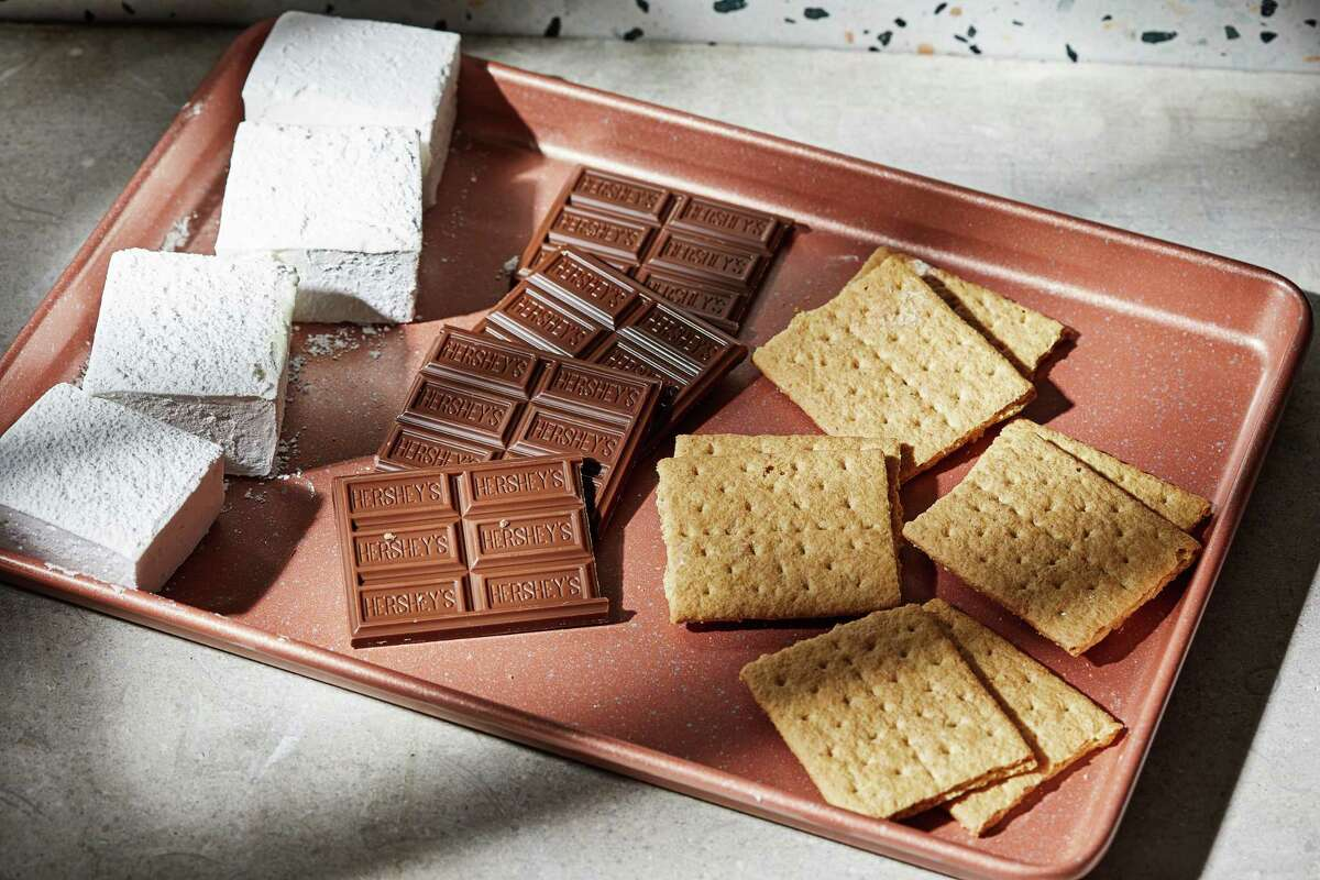 The classic s'more ingredients include marshmallows, milk chocolate and graham crackers.