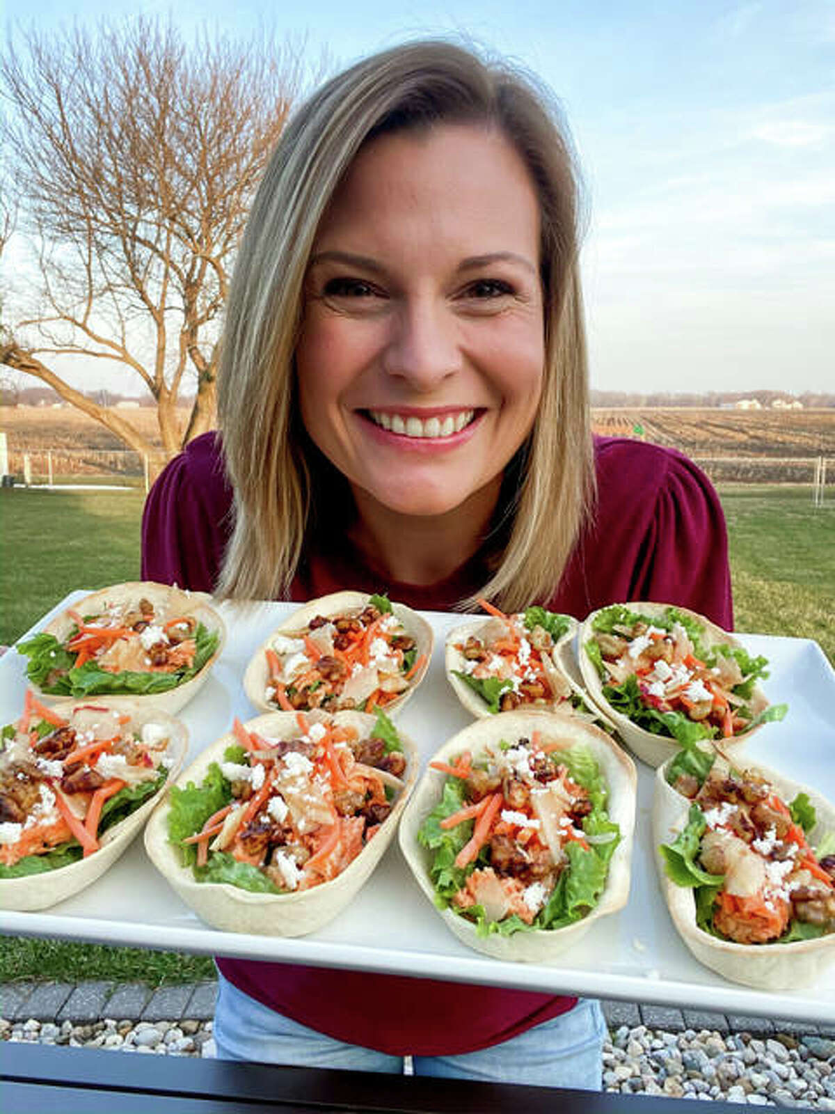 Rachel serving her Buffalo Chicken Tacos, adopted after a Buffalo Chicken Salad dish at Jack's Urban Eats based in California. The dish features a mixture of walnuts and apples with a kick of buffalo sauce.