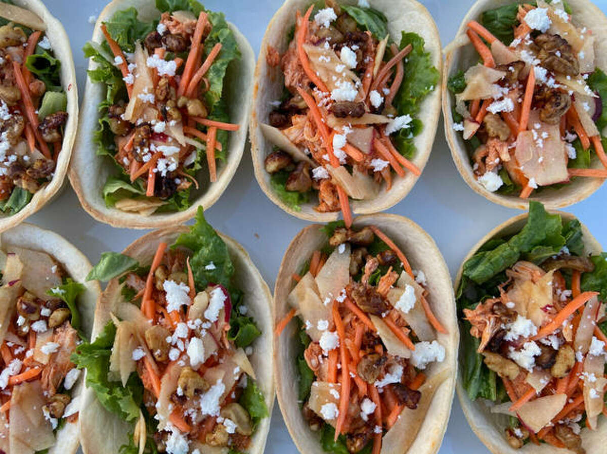 Buffalo Chicken Tacos, adopted after a Buffalo Chicken Salad dish at Jack's Urban Eats based in California, features a mixture of walnuts and apples with a kick of buffalo sauce.