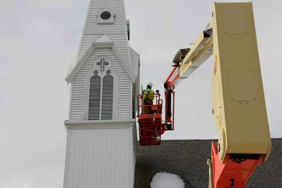 The United Methodist Church in Caseville has began repair work to the steeple, including replacing rotting external wood with vinyl. Church members hope the community will consider donating to the repair cost, continuing the preservation of the long-standing beacon of light. (Paige Withey/Huron Daily Tribune)