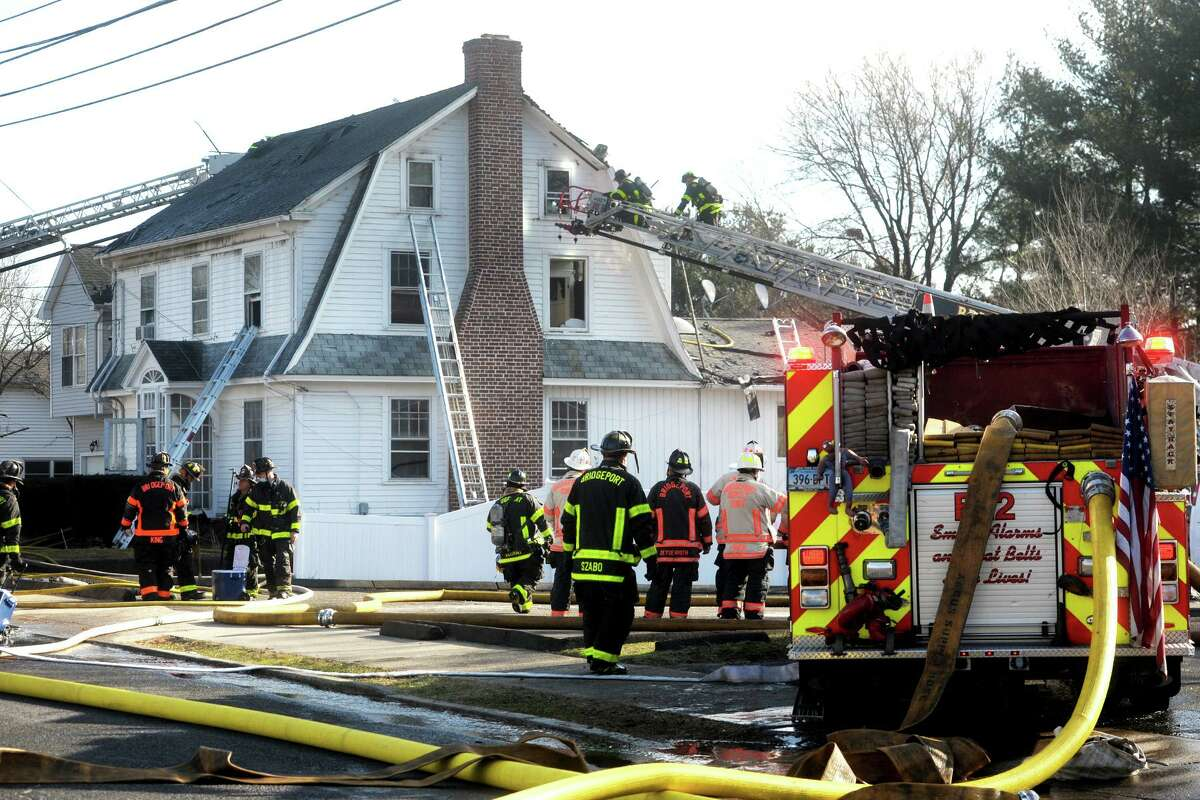 Firefighters at the scene following a fire in a home on Ochsner Place Jan. 12, 2021.
