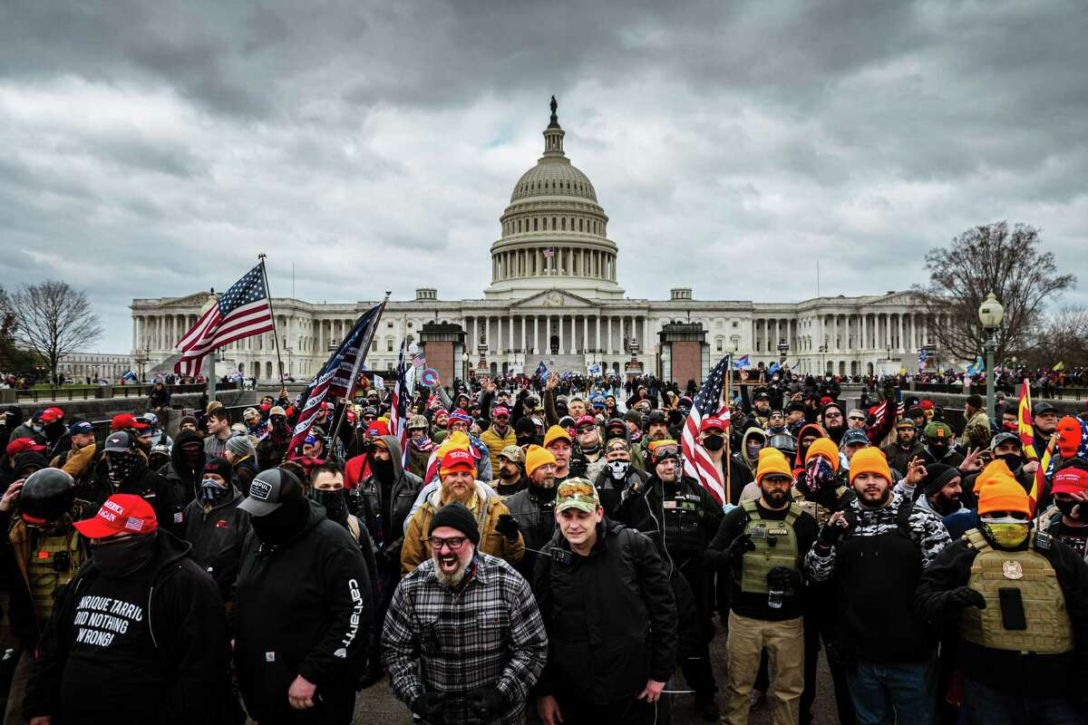 WASHINGTON, DC - JANUARY 06: Pro-Trump protesters gather in front of the U.S. Capitol Building on January 6, 2021 in Washington, DC. A pro-Trump mob stormed the Capitol, breaking windows and clashing with police officers. Trump supporters gathered in the nation's capital today to protest the ratification of President-elect Joe Biden's Electoral College victory over President Trump in the 2020 election. (Photo by Jon Cherry/Getty Images/TNS) ** OUTS - ELSENT, FPG, CM - OUTS * NM, PH, VA if sourced by CT, LA or MoD **