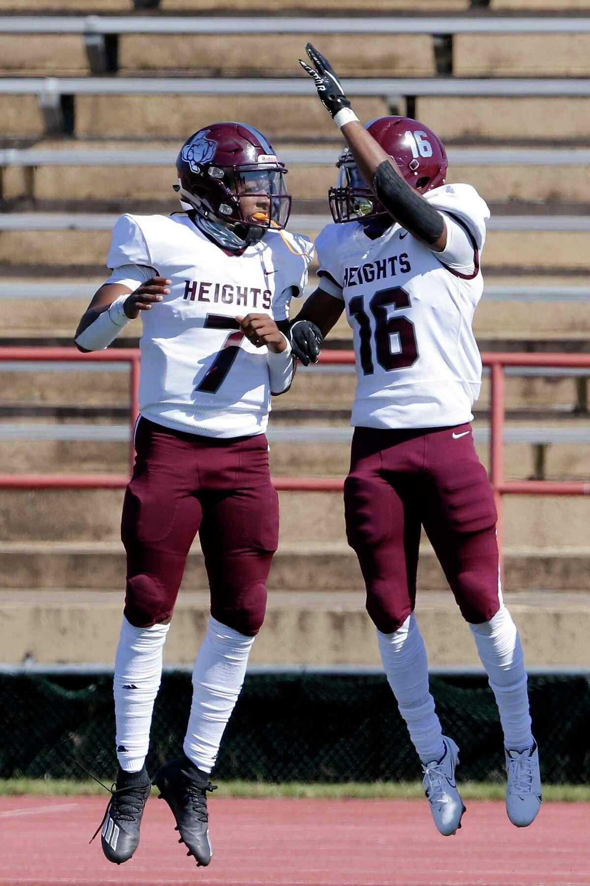 Heights quarterback Jalen Morrison (7) and receiver Keyondrick Douglas (16) celebrate Douglas' touchdown during their their game against Westside at Butler Stadium Saturday, Oct. 31, 2020 in Houston, TX.