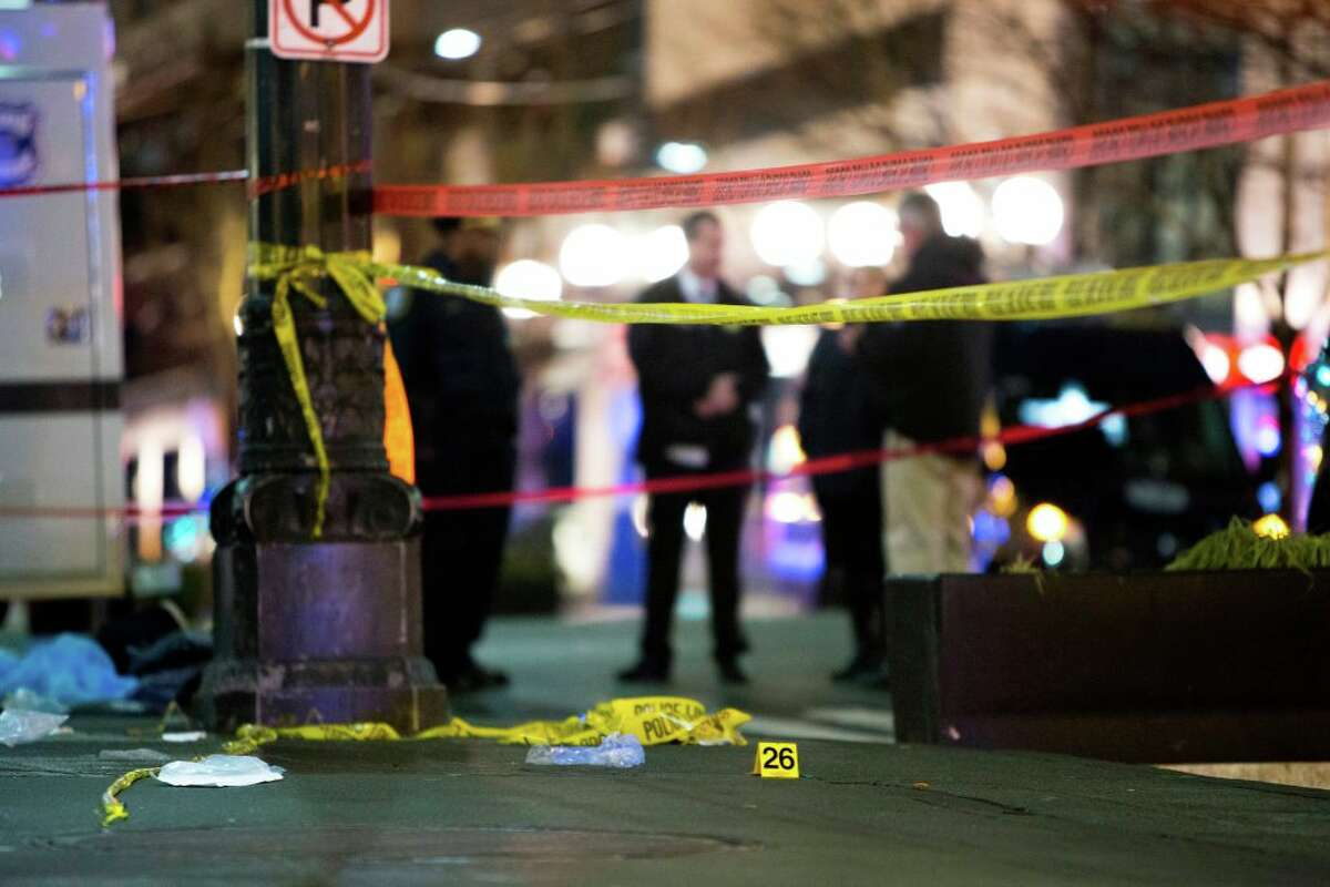 An evidence marker is pictured at the scene of a shooting that left one person dead and seven injured, including a child, in downtown Seattle, Washington on January 22, 2020. At least one person was killed and seven others, including a child, were wounded on Wednesday after gunfire broke out in downtown Seattle near a popular tourist area, police and hospital officials said. Police said at least one suspect was being sought in connection with the mass shooting that took place near a McDonald's fast food restaurant, just blocks away from the Pike Place Market.