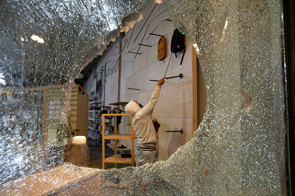 SEATTLE, WA - MAY 30: Looters ransack an Urban Outfitters store following a peaceful rally expressing outrage over the death of George Floyd on May 30, 2020 in Seattle, Washington. Protests have erupted nationwide after Floyd died while in the custody of police in Minneapolis. (Photo by Karen Ducey/Getty Images)