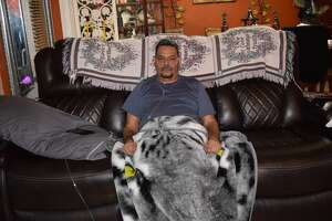 Francisco Gonzalez of Muleshoe sits on a couch in his home after sharing his testimony about hismiraculous recovery after a two-month hospital stay due to COVID-19.