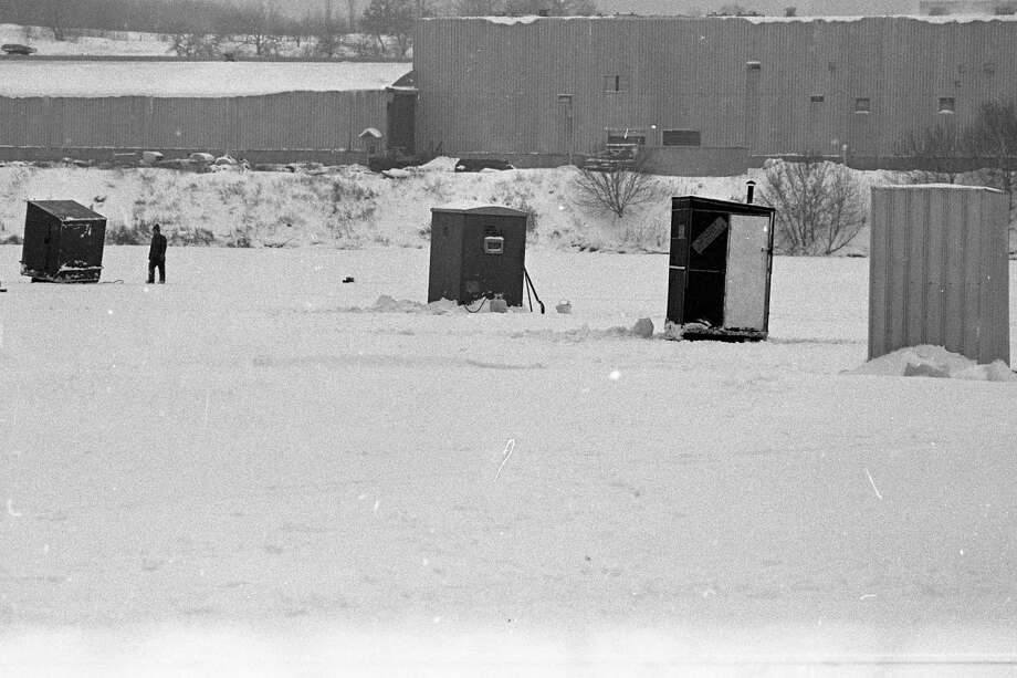 This photo is from the front page of the News Advocate on this day in 1981. The wind may blow, and the snow may fly but a man's fishing shanty is his refuge from the weather, a haven of warmth on the expanse of ice that was once, and again will be, Manistee Lake. Incidentally, some nice perch and a few pike are being caught by the occupants of these havens of warmth. (Manistee County Historical Museum photo)